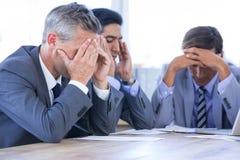有膝上型计算机和数字式片剂的同事在会议 库存图片