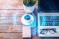 有膝上型计算机咖啡杯的企业工作场所和在屏幕上的安全概念 免版税库存照片