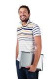 有膝上型计算机微笑的男学生 免版税库存照片