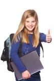 有膝上型计算机微笑的赞许的女小学生 免版税库存图片