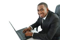 有膝上型计算机的商人 库存照片