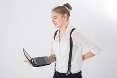 有膝上型计算机的女孩在手中 库存照片