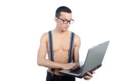 有膝上型计算机的性感的书呆子 免版税图库摄影