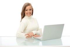 有膝上型计算机的愉快的女实业家 库存照片