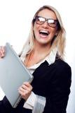 有膝上型计算机的愉快的妇女 免版税库存照片