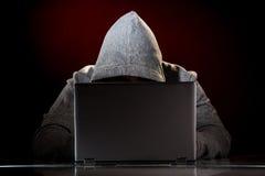 有膝上型计算机的黑客 免版税图库摄影