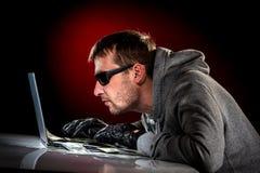 有膝上型计算机的黑客 图库摄影
