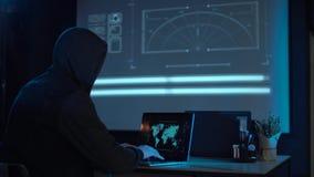 有膝上型计算机的黑客 库存照片