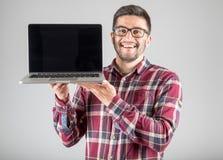 有膝上型计算机陈列的人screeen 图库摄影