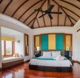 有自然太阳的泰国样式床室 图库摄影
