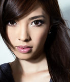 有至善至美的皮肤的美丽的亚裔少妇 库存图片