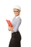 有艰苦的年轻微笑的妇女建筑工人 免版税库存照片