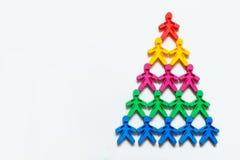 有色种人的运作的金字塔标志白色背景的 免版税库存照片
