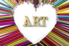 有艺术文本的颜色铅笔 库存图片