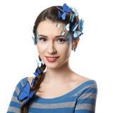 有艺术构成蓝色蝴蝶的女孩 免版税库存照片