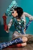 有艺术脸的时髦的女人 免版税库存照片