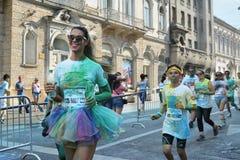 有芭蕾舞短裙的妇女赛跑者 库存照片