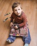 有芯片使用的小男孩 图库摄影