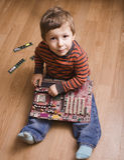 有芯片使用的小男孩 库存图片
