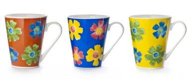 有花卉摘要的杯子 库存图片