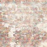 有花卉样式的脏的破旧的葡萄酒砖墙 免版税库存图片