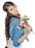 有花束的美丽的女孩 免版税库存照片