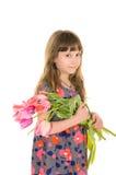 有花的俏丽的女孩妈妈的 免版税图库摄影