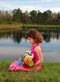 有花的女孩 库存照片