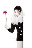 有花的女性小丑在手中 免版税图库摄影