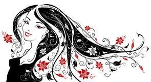 有花的妇女在她的头发 免版税库存图片