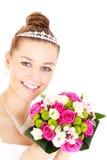 有花的愉快的新娘 免版税库存图片