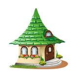 有花的童话房子 免版税库存图片