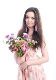 有花的美丽的女孩在白色背景 免版税图库摄影