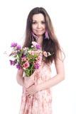 有花的美丽的女孩在白色背景 免版税库存图片