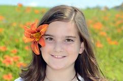 有花的美丽的女孩 图库摄影