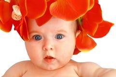 有花的逗人喜爱的女婴 库存照片