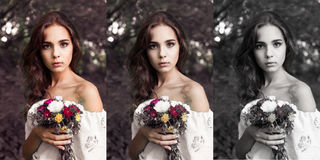 有花花束的俏丽的女孩  库存照片