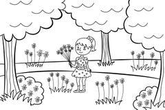 有花花束的小女孩在公园。 免版税库存照片