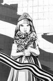 有花绘的年轻俄国孩子 免版税库存照片