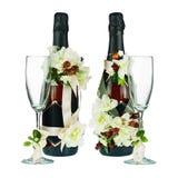 有花Ar的玻璃和婚礼装饰的香宾瓶 免版税库存照片