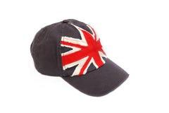 有英国旗子的深蓝棒球帽 库存图片