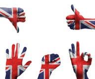 有英国的旗子的手 库存图片