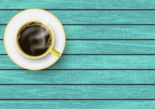有茶碟的现实黄色和加奶咖啡杯子在蓝色葡萄酒木桌,顶视图上 库存图片