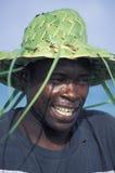 有草帽的,多巴哥愉快的人 免版税库存照片