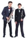有萨克斯管和单簧管的男孩 库存照片