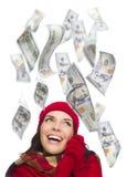 有落在她附近的$100张票据的年轻激动的妇女 图库摄影