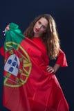 有葡萄牙的旗子的美丽的妇女 库存照片
