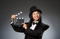 有葡萄酒帽子的妇女和电影上 库存图片