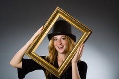 有葡萄酒帽子的妇女= 库存图片