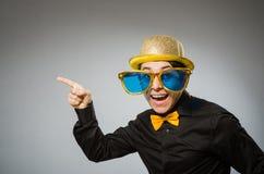 有葡萄酒帽子的滑稽的人 免版税库存图片